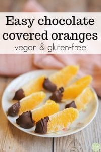 Text overlay: Easy chocolate covered oranges. Vegan & gluten-free. Plate with chocolate dipped oranges on it.