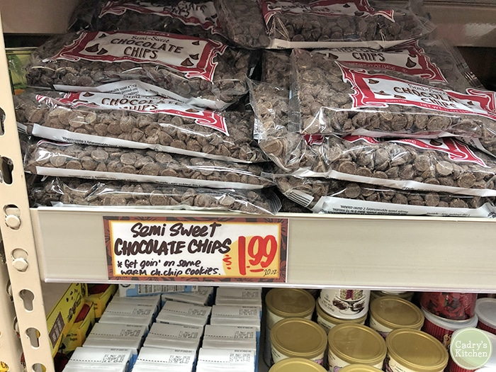 Bags of chocolate chips on display at Trader Joe's.