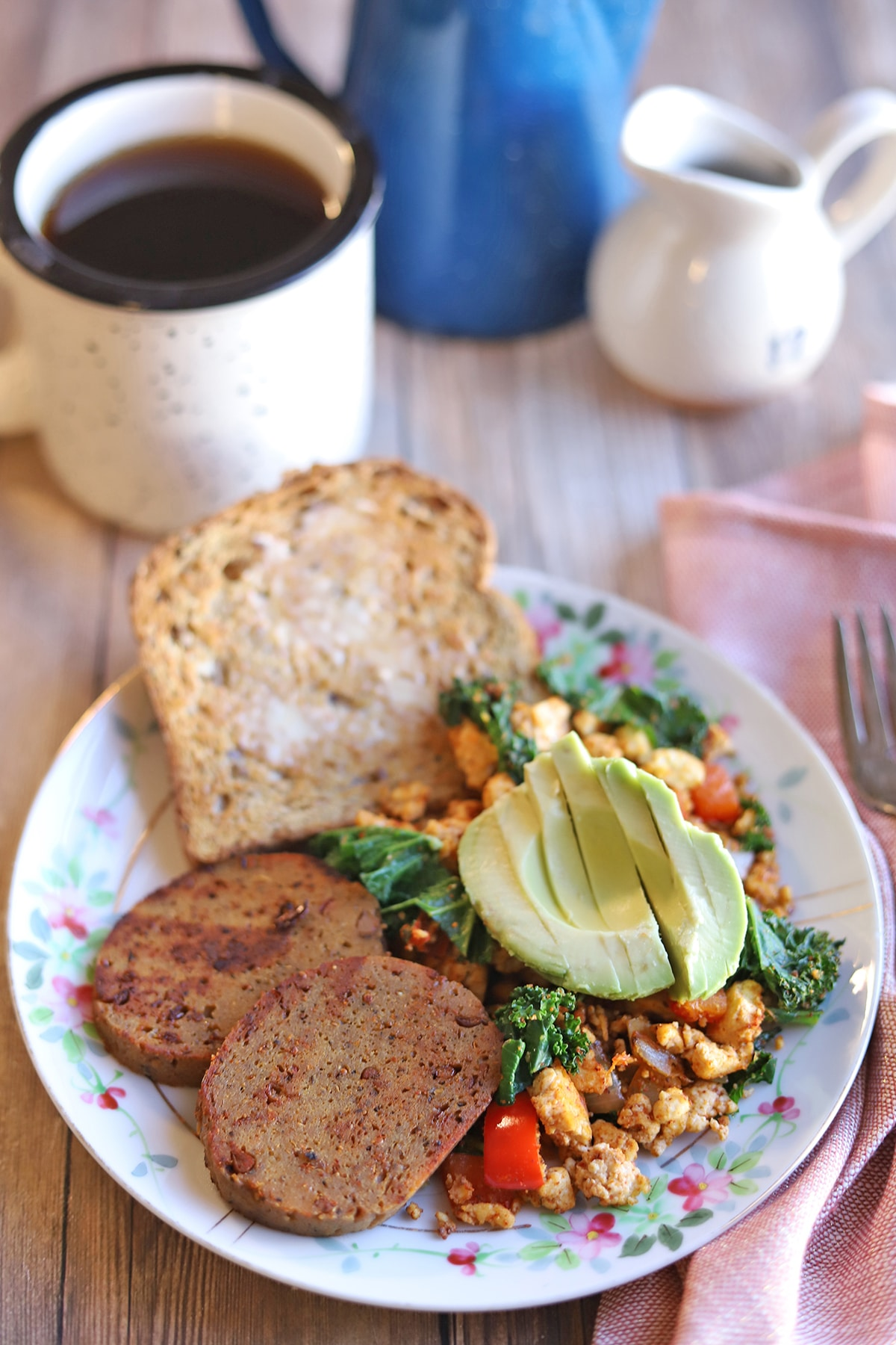 Maple mustard sausage slices on plate with tofu scramble and toast.