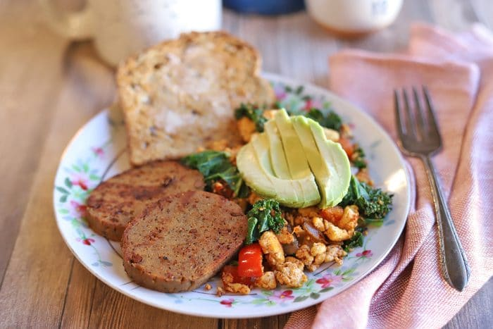 Breakfast plate with maple mustard sausage, toast, and tofu scramble.