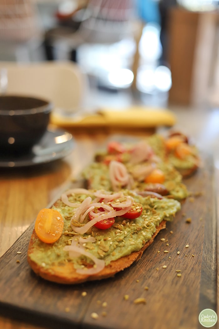 Avocado toast with shallots and tomatoes at Proper and Wild.