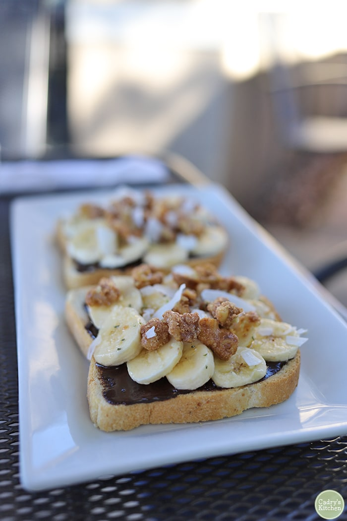 Toast with chocolate spread and bananas on plate at Sanctum.