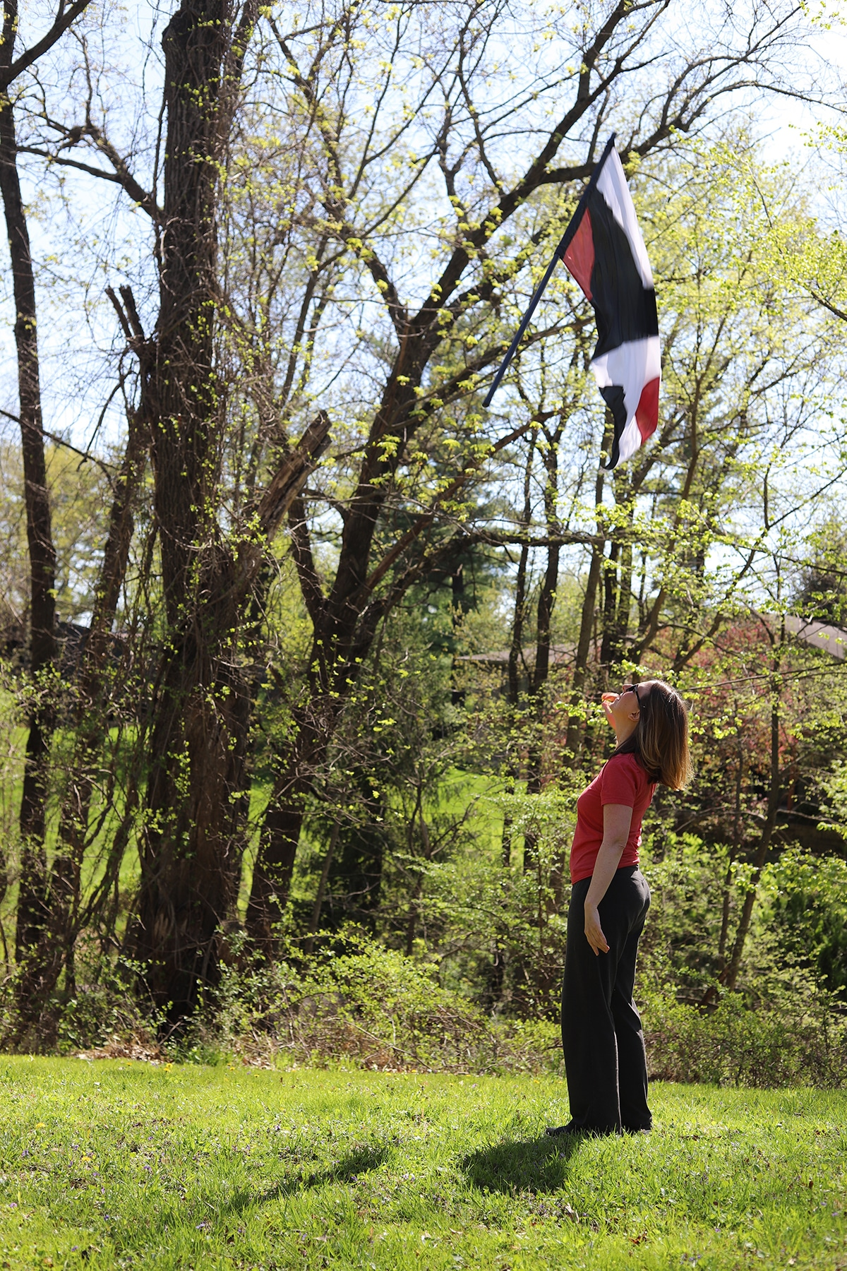 Cadry tossing Color Guard flag in yard.