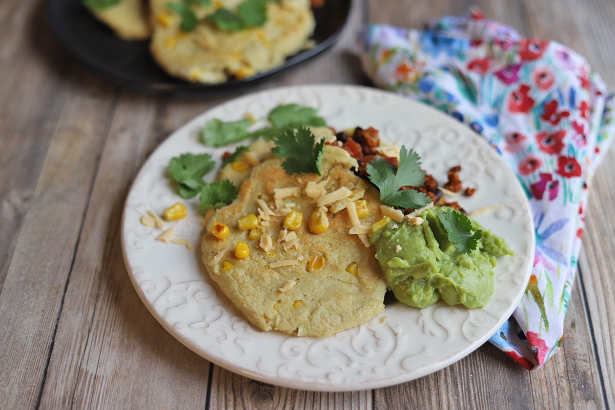 Corn cakes with soyrizo, guacamole, and cilantro.