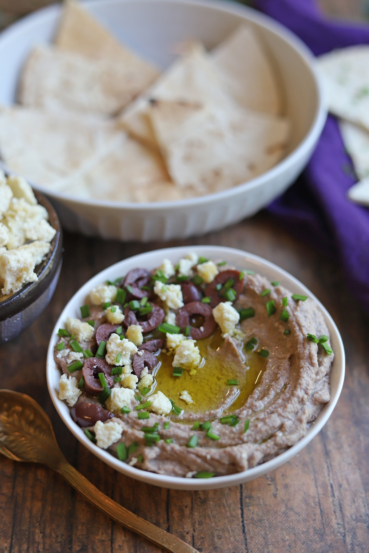 Bowl of chickpea dip with toasted pita.