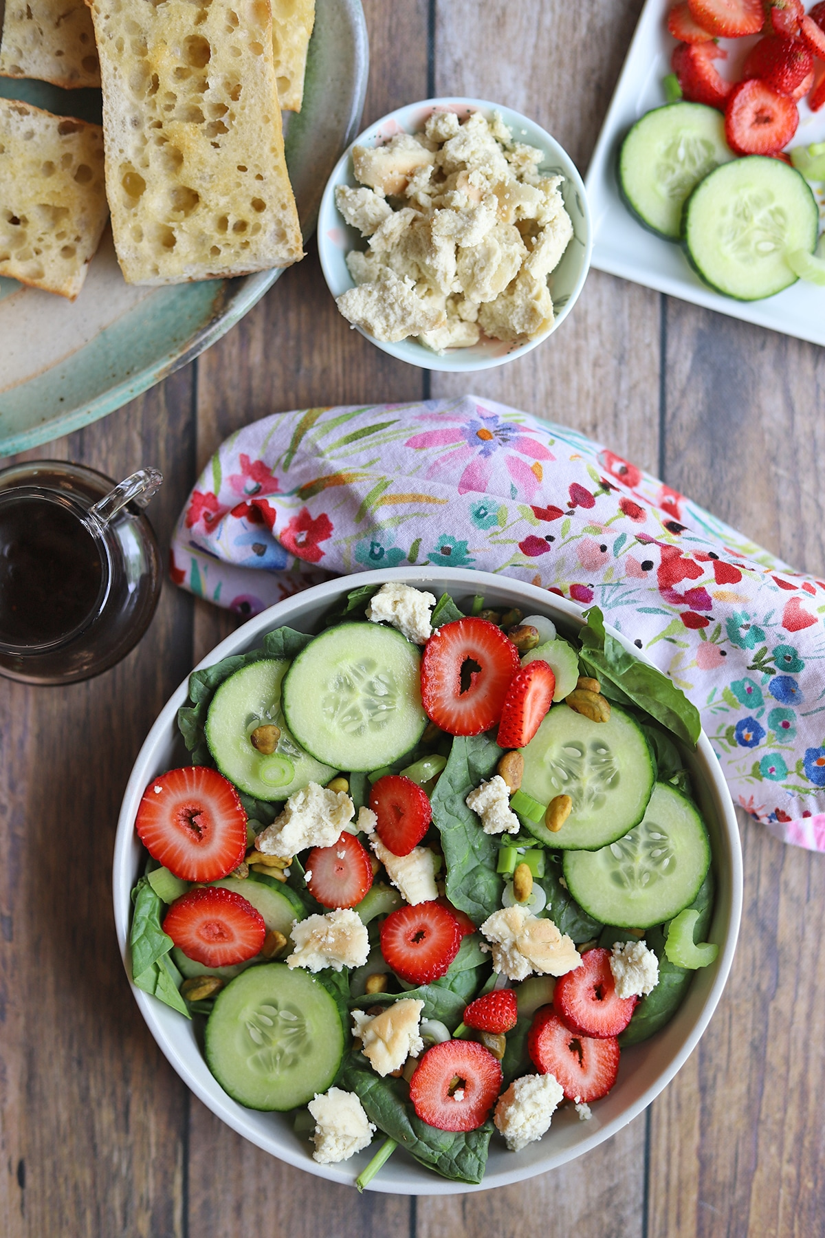 Overhead bowl of salad on table with balsamic vinaigrette.
