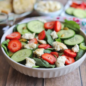 Bowl of salad with strawberries and vegan feta.