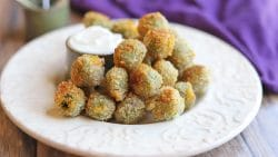 Fried olives on plate with aioli dipping sauce.