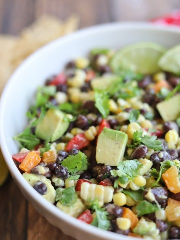 Close-up salad with corn, avocado, bell pepper, and black beans.