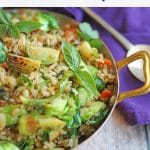 Text overlay: Vegan fried rice with Brussels sprouts. Skillet with fried rice on table.