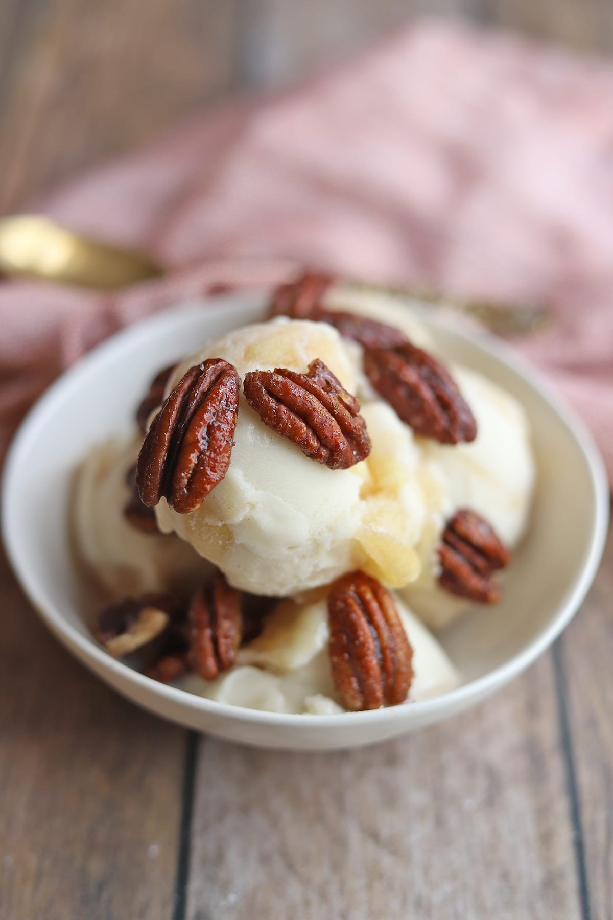 Candied pecans on bowl of non-dairy ice cream.