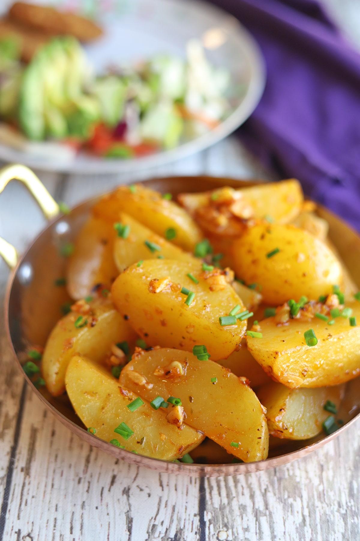 Close-up Yukon gold potatoes in serving dish.
