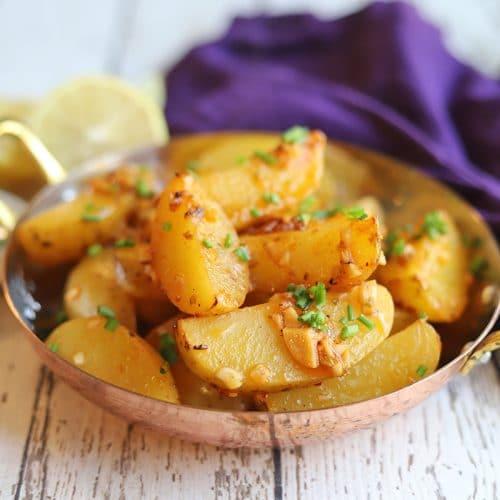 Greek potatoes in serving dish.