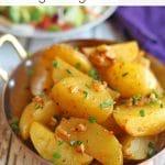 Text overlay: Lemony potatoes. Vegan and gluten-free. Potatoes in serving dish.