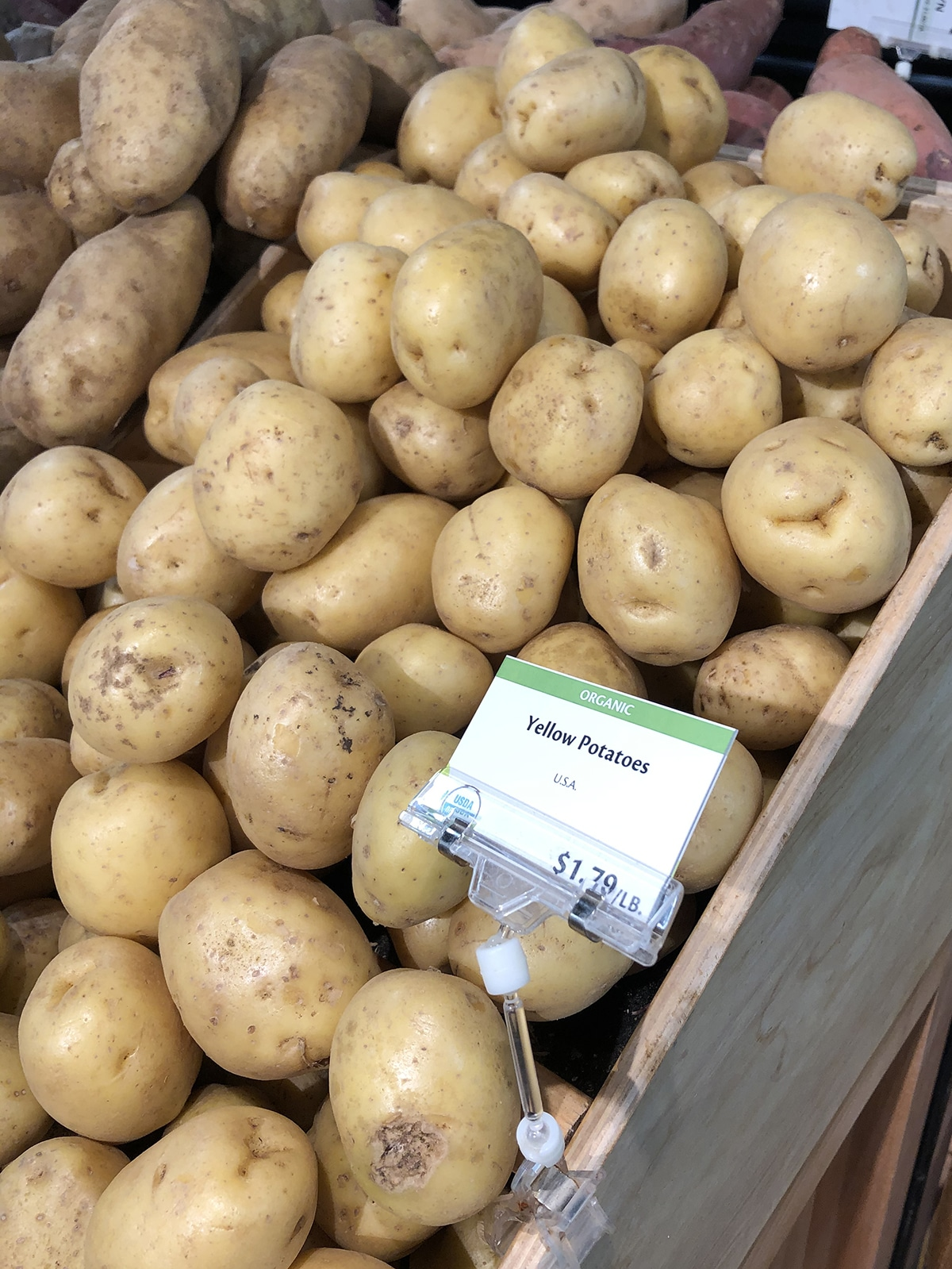 Yellow potatoes on display at grocery store.