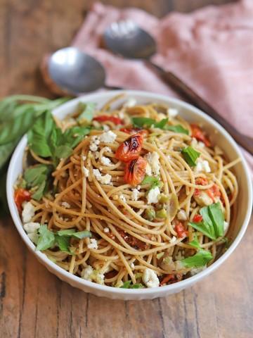 Mediterranean pasta in bowl with basil.