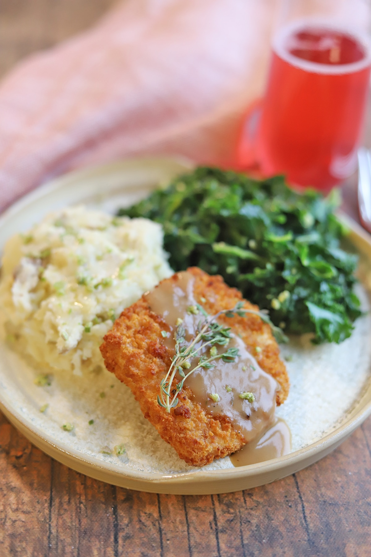 Thanksgiving for two with Gardein turk'y cutlet, mashed potatoes, and kale on plate.