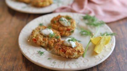 Vegan crab cakes on plate with lemon dill aioli.