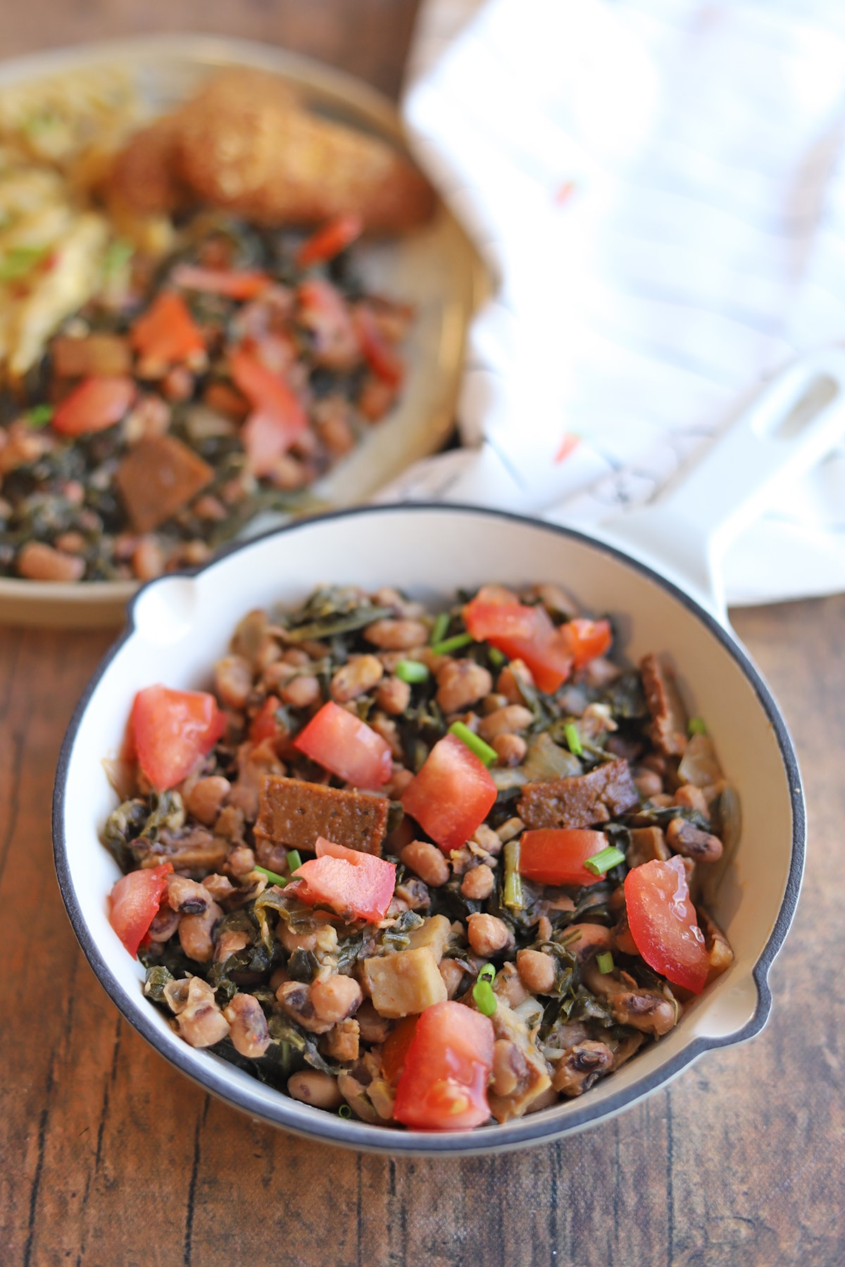 Overhead skillet with collard greens and black-eyed peas.