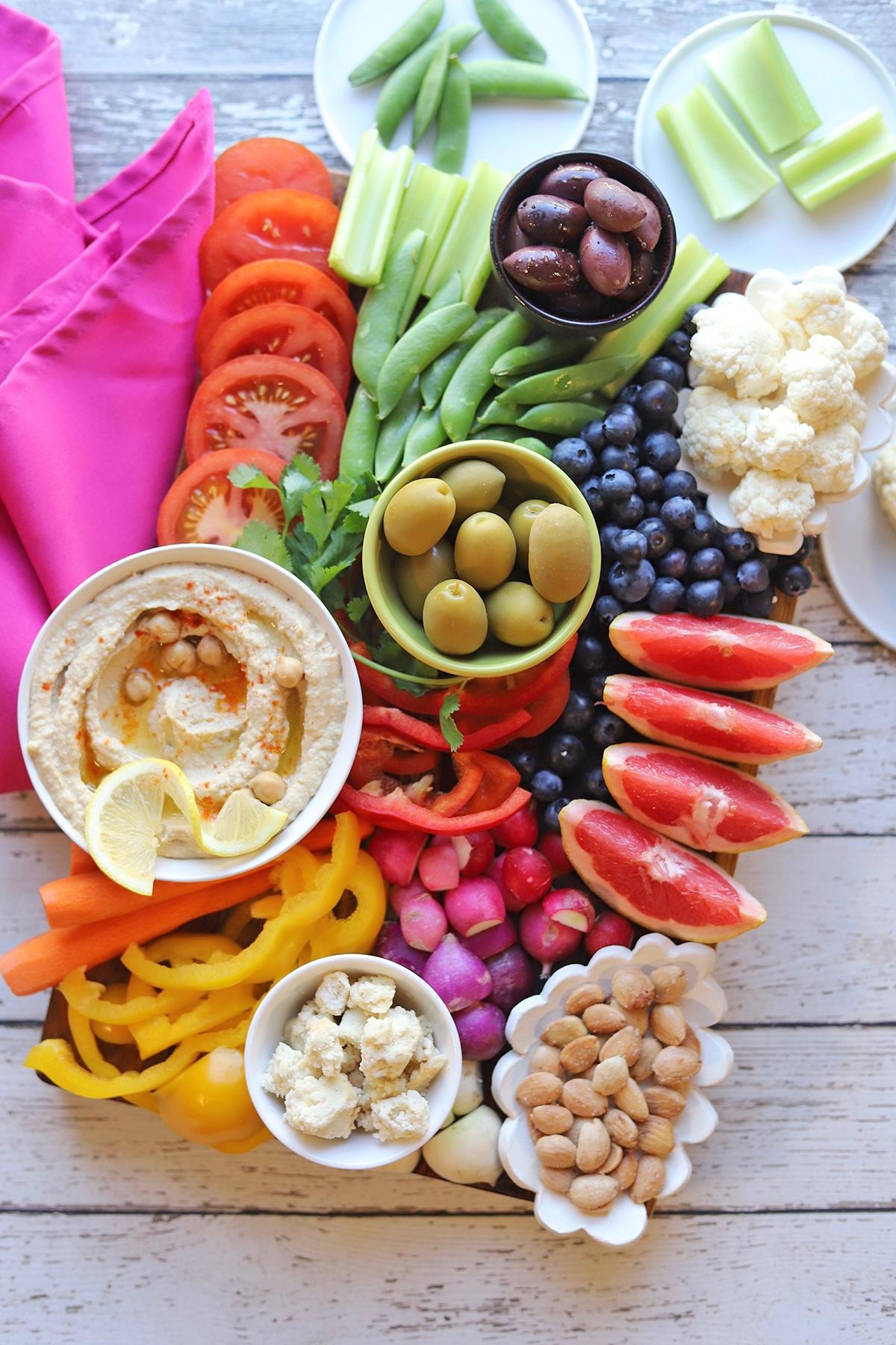 Colorful veggie platter on table.