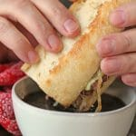 Text overlay: Top 10 reader favorites from Cadry's Kitchen. Hands dipping sandwich into au jus.