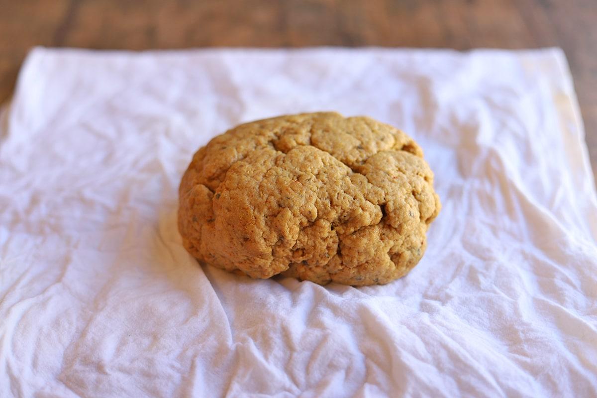 Gluten loaf on dampened tea towel.