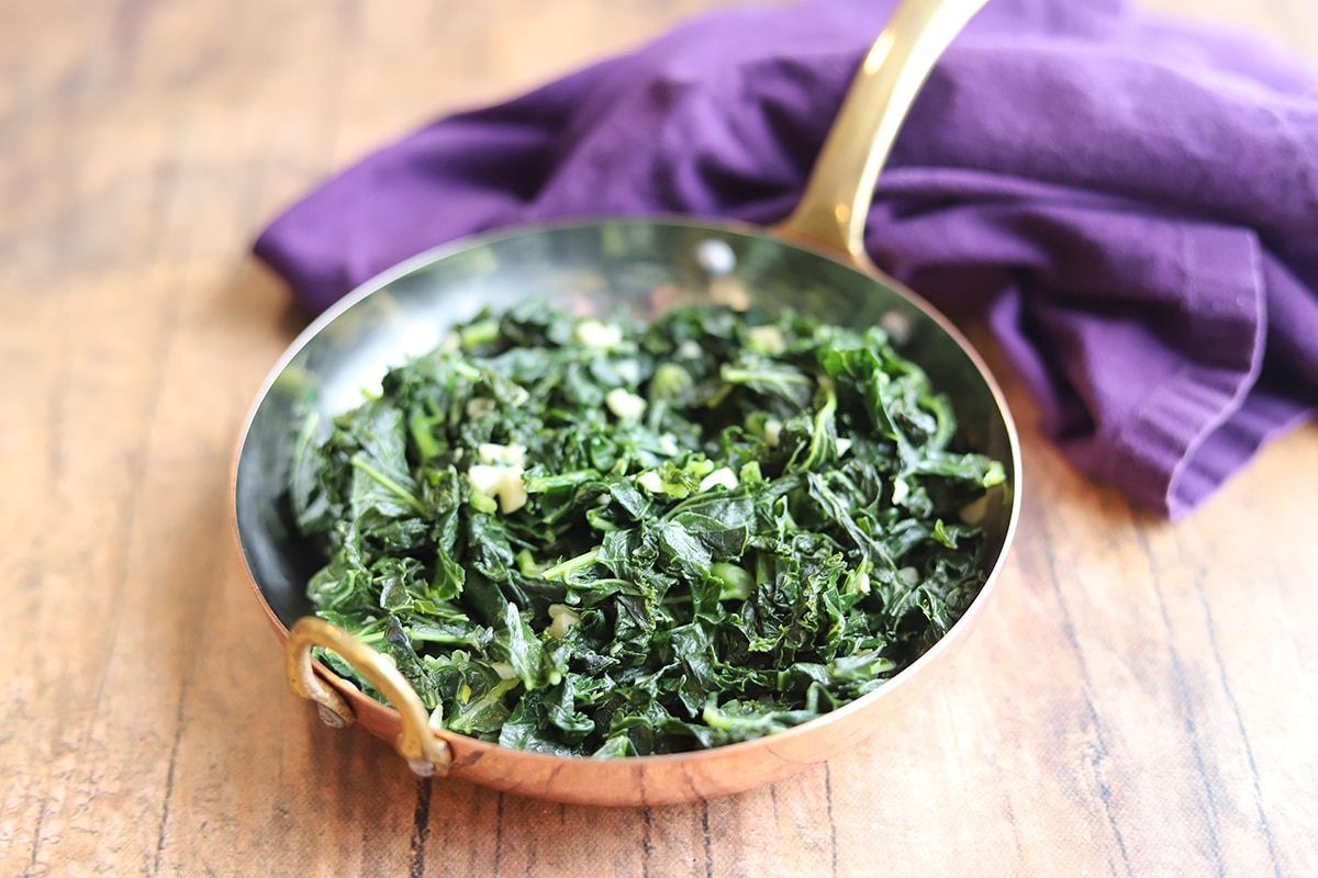 Sauteed kale and garlic in pan.
