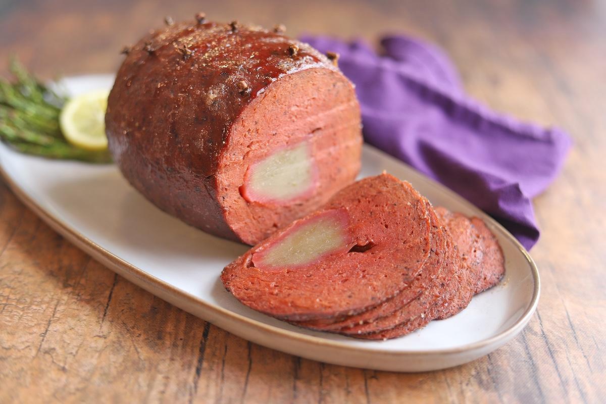 Sliced vegan ham with maple syrup & brown sugar glaze.