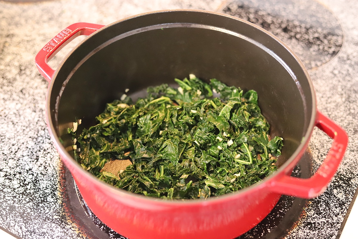Sauteed kale in pot with garlic.