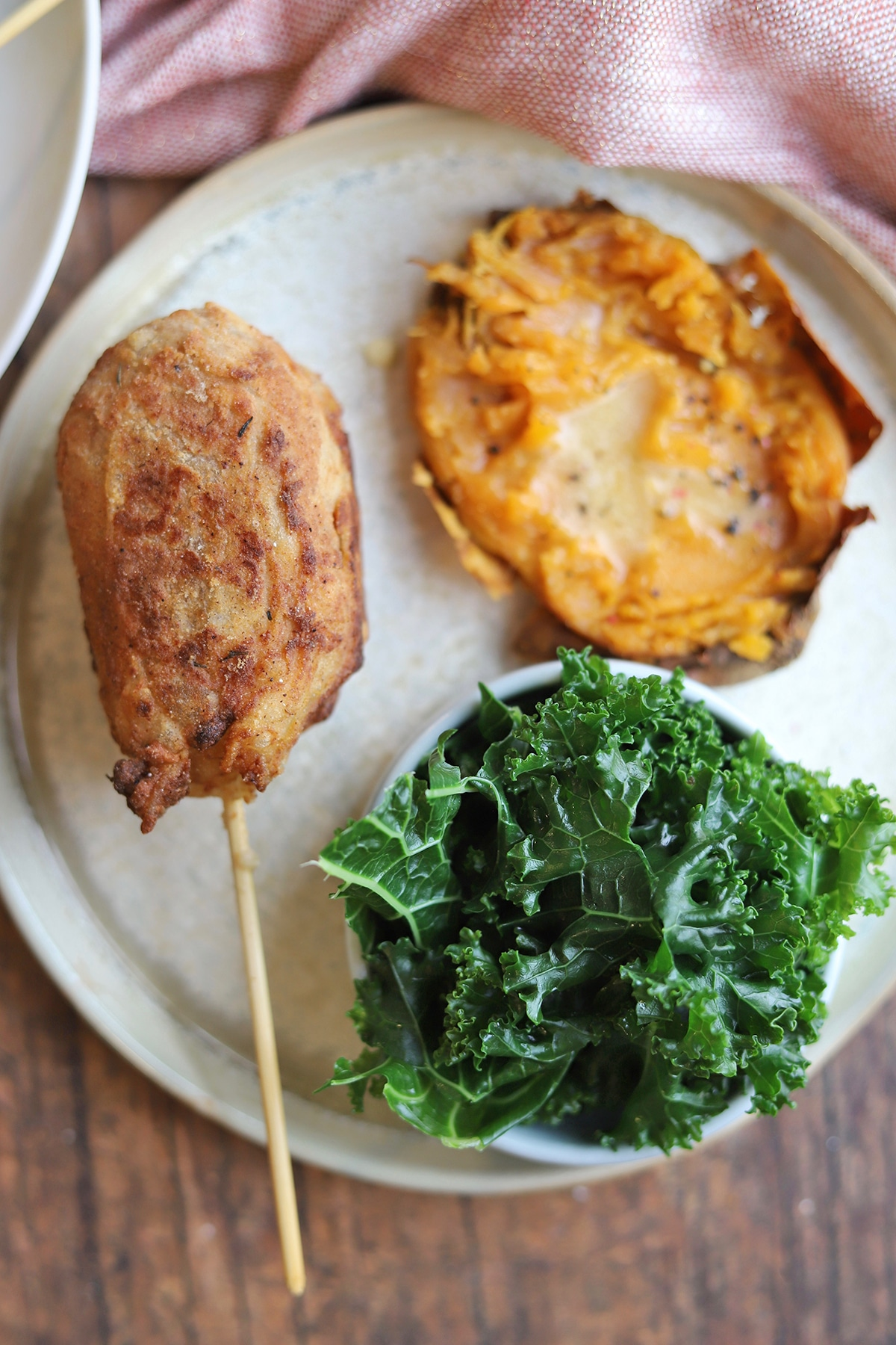 Vegan fried chicken with sweet potato and kale.