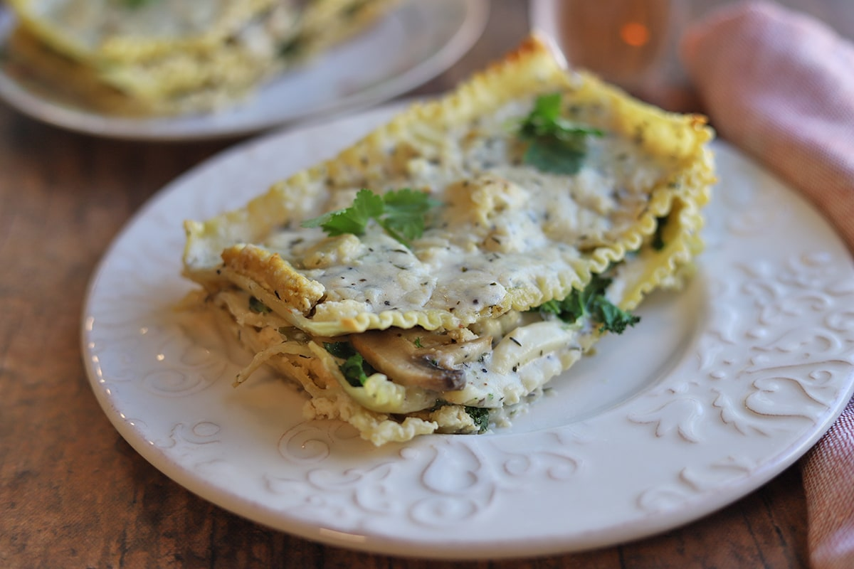 White lasagna with herbed alfredo sauce, mushrooms, and kale.
