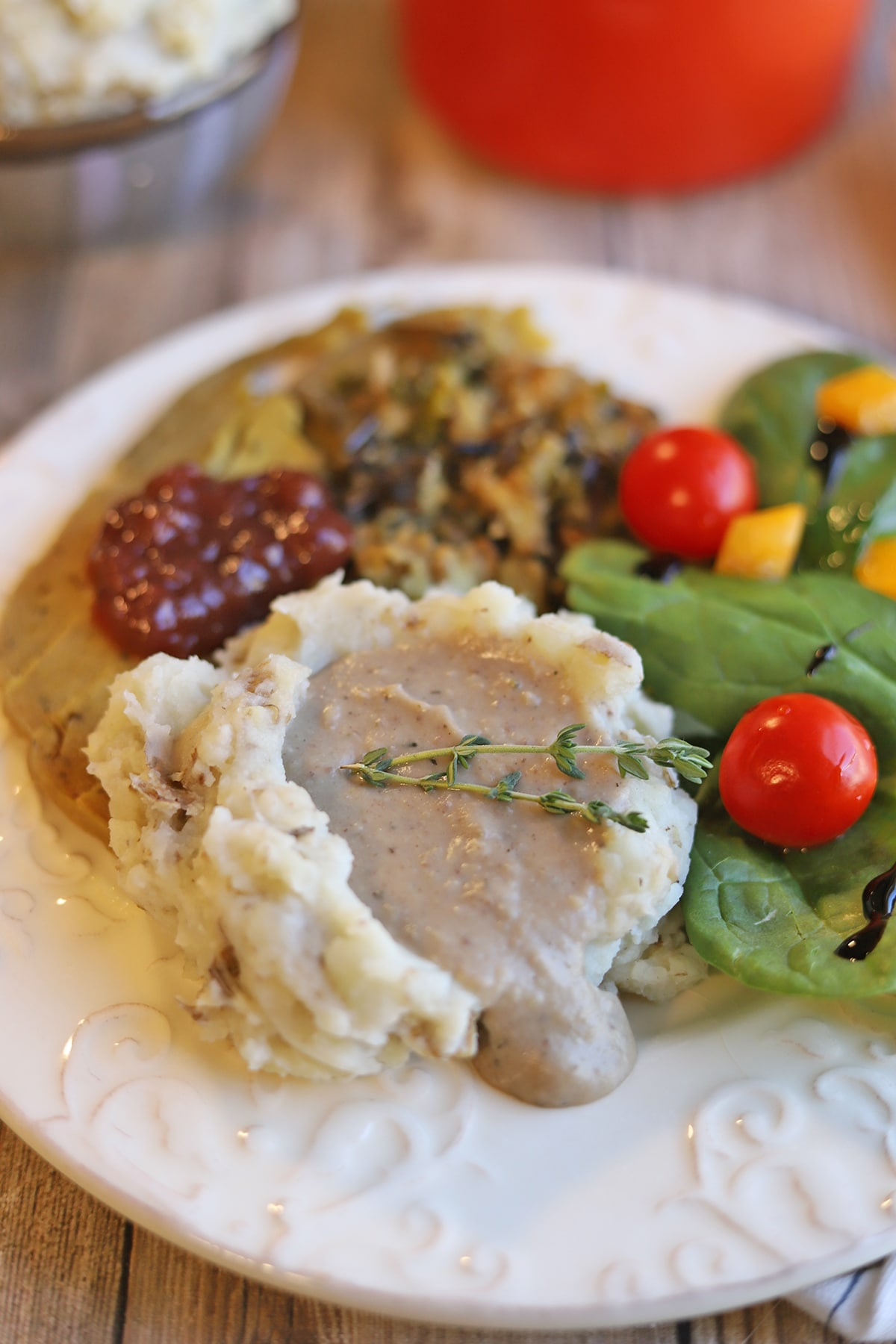 Chestnut gravy on mashed potatoes with salad and holiday roast.