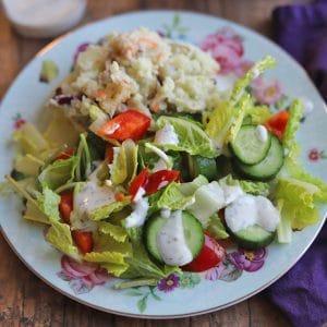 Vegan ranch dressing on top of salad.