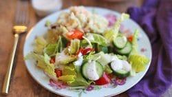 Salad on plate with potato salad.