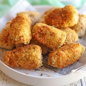 Pile of fried artichoke hearts on platter.