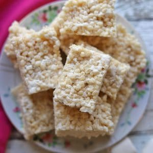 Stack of vegan rice crispy treats on plate.