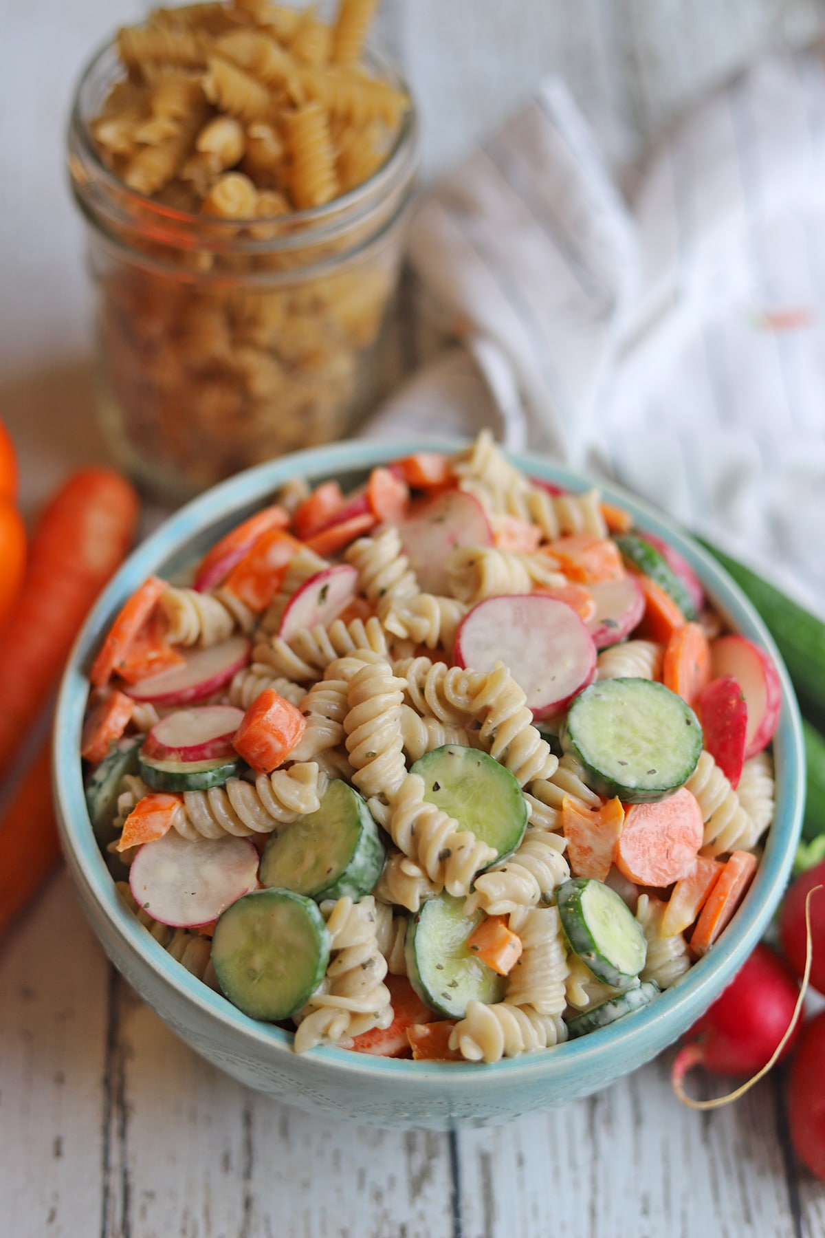 Vegan pasta salad in bowl on table.