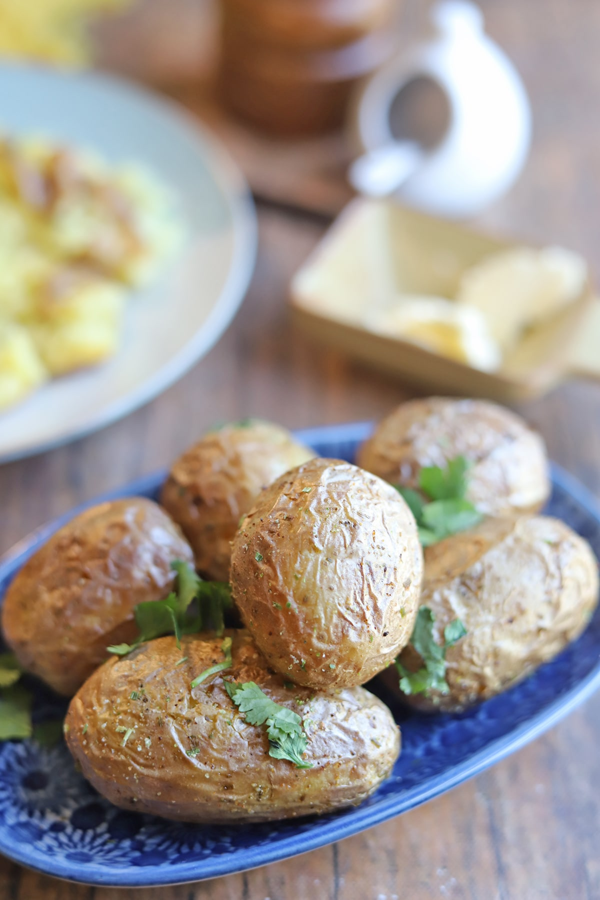 Air fried baby potatoes on table by non-dairy butter and salt.