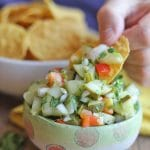 Text overlay: Pickle salsa. Chip dipping into salsa.