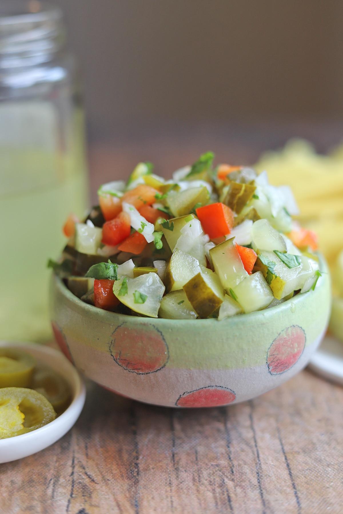 Pickle salsa in polkadot bowl.