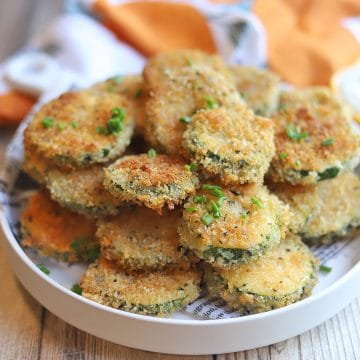 Platter with stacks of fried zucchini slices.