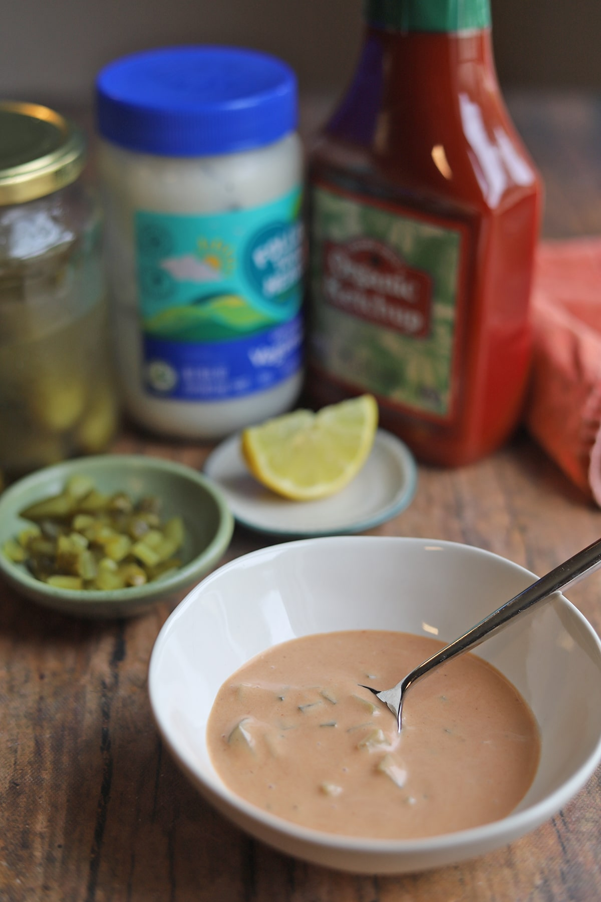 Thousand Island dressing in small bowl by ingredients.