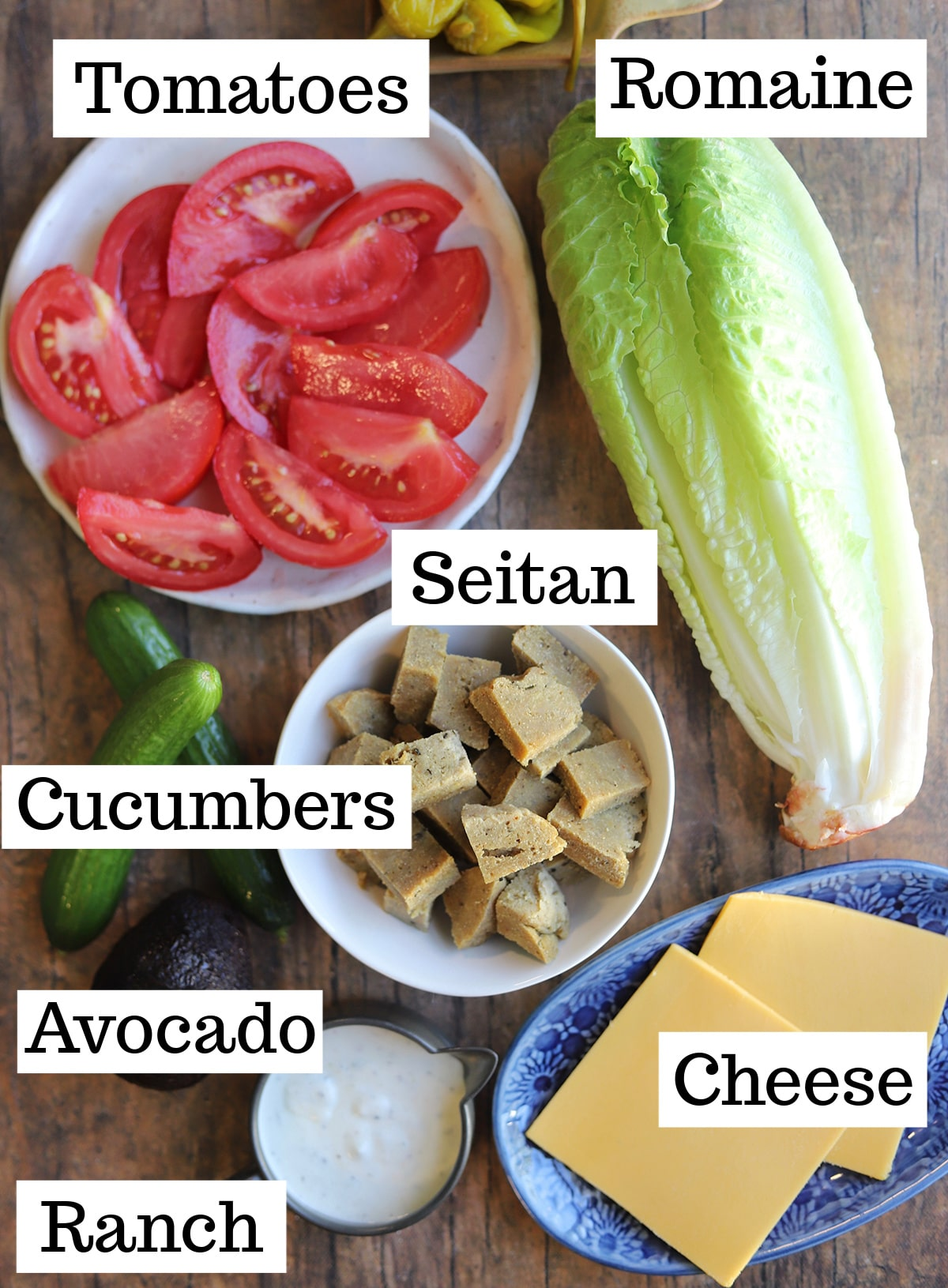 Labeled ingredients for salad on table.