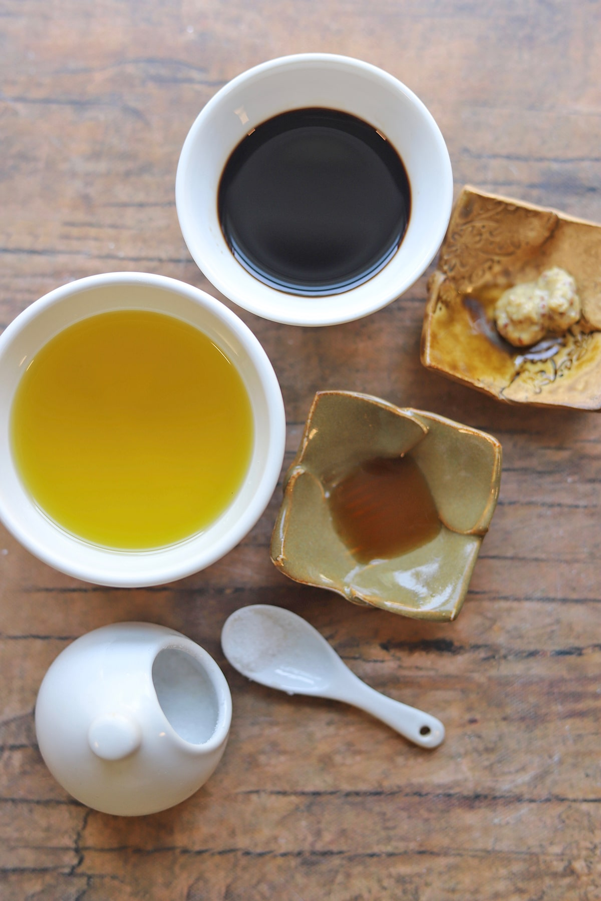 Overhead balsamic vinaigrette dressing ingredients on table.