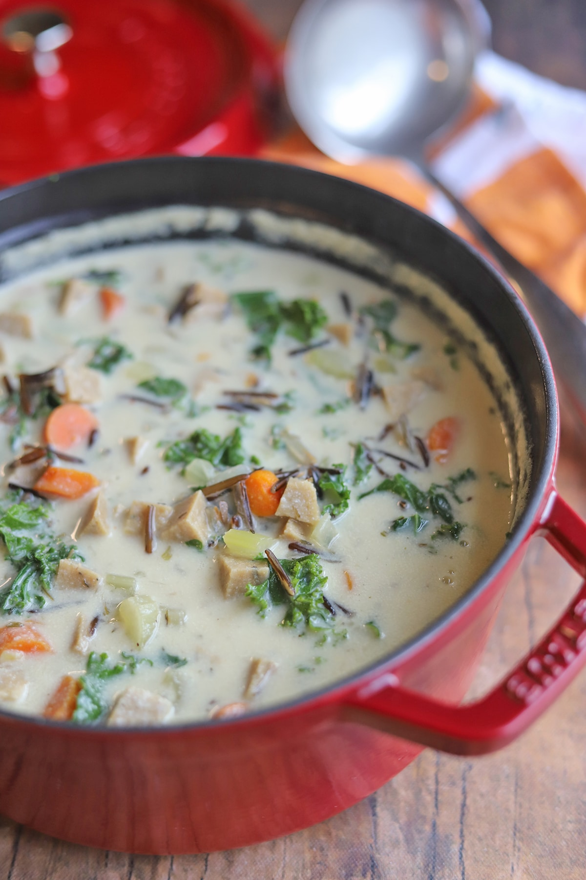 Staub Dutch oven filled with wild rice soup.